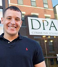 Dominic Amenta, founder of DPA Communications, in front of his North End office.