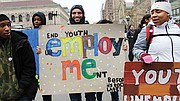 """Young protesters participating in the """"Dreams of our Future"""" rally at Copley Square."""