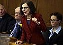 Jan. 9, 2017 file photo of Oregon Gov. Kate Brown during her inaugural speech. She told a Senate panel that the anguished voices of gun violence will not be silenced in the wake of the recent mass shooting in Florida.