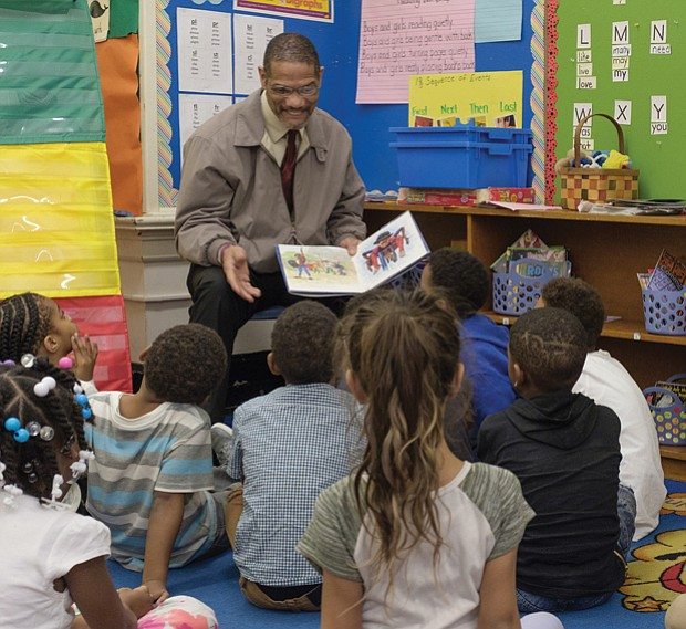 The joy of reading // Theodore Mosley reads to first-graders at Bellevue Elementary in Church Hill last Friday. Mr. Mosley was part of the 100 Men Read project of Mt. Gilead Full Gospel International Ministries. Sheriff Irving was taking part in the annual Read Across America effort to read to children in schools and day care centers. The National Education Association sponsors the effort to promote reading and honor the late noted children's author Dr. Seuss. Additional volunteers will read to children in Richmond Public Schools and other area schools and programs on Friday, March 2, the birthday of Dr. Seuss, the pen name of Theodor S. Geisel.