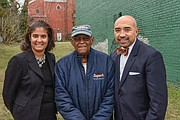 Neverett A. Eggleston Jr., center, who helped found the Metropolitan Business League in 1968, stands with Carla P. Childs and Gary L. Flowers on the site of the organization's original home on 2nd Street near Jackson Street in Jackson Ward.
