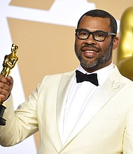 """Jordan Peele, winner of the award for best original screenplay for """"Get Out"""", poses in the press room at the Oscars on Sunday, March 4, 2018, at the Dolby Theatre in Los Angeles. (Photo by Jordan Strauss/Invision/AP)"""