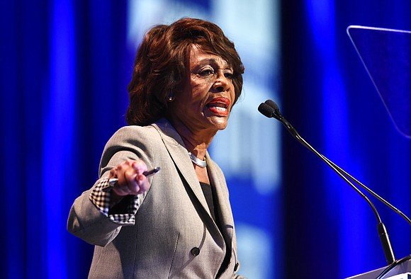 A black congresswoman says President Donald Trump is racist for joking about her intelligence and again called for his impeachment.