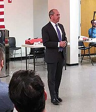 Gubernatorial candidate Jay Gonzalez appeals to voters during Dorchester's Ward 17 Democratic Caucus.