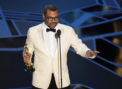 Jordan Peele became the first African American to win an Oscar for best original screenplay for his film 'Get Out,' at Sunday's 90th annual Academy Awards.  (AP photo)