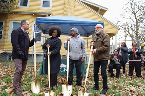 A ground breaking ceremony on North Williams Avenue celebrates the future site of four new townhouses reserved for low and moderate income families displaced from north and northeast Portland. Pictured (from left) are Travis Phillips and Maxine Fitzpatrick of Portland Community Reinvestment Initiatives, Inc. (PCRI), Albina Construction Co-owner Dennis Harris, and Architect Brett Schultz.
