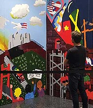 Murals focused on immigration themes are on display at the Bolling Municipal Building. BPS students created the works with guidance from their teachers and ARCK's teaching artists.