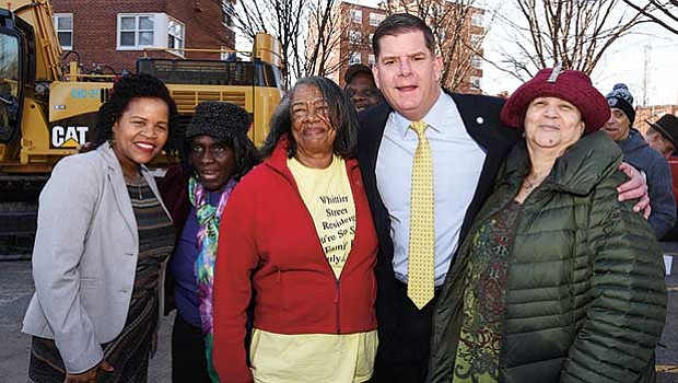 Mayor Martin Walsh celebrates with residents during Phase 1 of the Whittier Street public housing project breaks ground in Roxbury.