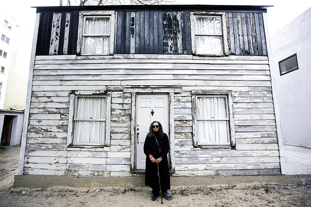 In this April 6, 2017 file photo, Rhea McCauley, a niece of the late civil rights activist Rosa Parks, poses in front of the rebuilt house of Rosa Parks in Berlin. Brown University announced Thursday, March 8, 2018, it has canceled plans to display the house where Parks lived after sparking the Montgomery bus boycott. (AP Photo/Markus Schreiber, File)