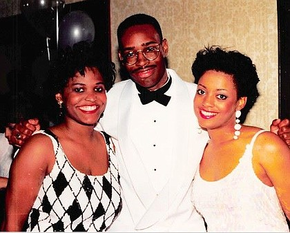 Susan Bynam, Larry Green, and Rhonda Williams celebrating their graduation from Texas Southern University's Thurgood Marshall Law School