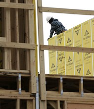 In this Monday, Feb. 26, 2018, photo, work continues on a new development in Fair Lawn, N.J. On Friday, March 9, the Labor Department reported that U.S. employers added 313,000 jobs in February, the most in any month since July 2016, and drawing hundreds of thousands of people into the job market. (AP Photo/Seth Wenig, File)