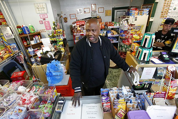 In this Feb. 26, 2018, file photo, Carl Lewis in his market in Rankin, Pa. About half of Lewis' customers pay with benefits from the federal Supplemental Nutrition Assistance Program, so the government's proposal to replace the debit card-type program with a pre-assembled box of shelf-stable goods delivered to recipients worries him and other grocery operators in poor areas. (AP Photo/Gene J. Puskar, File)