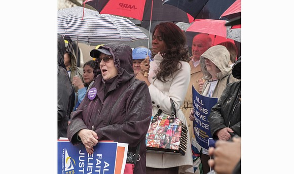 Under the shadow of the Bell Tower on Capitol Square, hundreds of people from across Virginia rallied on a rainy ...