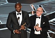"Retired NBA star Kobe Bryant, left, and Disney animator Glen Keane accept Oscars for best animated short for ""Dear Basketball"" at Sunday's awards show. Social media blew up, citing an irony in Mr. Bryant's winning an award in the #MeToo era calling out sexual harassment in light of the 2003 accusation that he sexually assaulted a Colorado hotel employee. The criminal case was dropped and the civil suit against him was settled out of court."