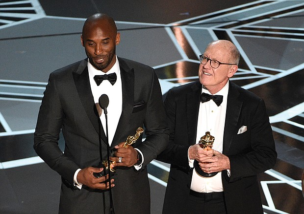 """Retired NBA star Kobe Bryant, left, and Disney animator Glen Keane accept Oscars for best animated short for """"Dear Basketball"""" at Sunday's awards show. Social media blew up, citing an irony in Mr. Bryant's winning an award in the #MeToo era calling out sexual harassment in light of the 2003 accusation that he sexually assaulted a Colorado hotel employee. The criminal case was dropped and the civil suit against him was settled out of court."""