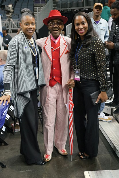 "There's no shortage of celebrities at the CIAA. Middle row from left: Mr. CIAA, Abraham ""Ham"" Mitchell, dressed in one of his signature outfits, takes a picture with fans during his walk through the arena."