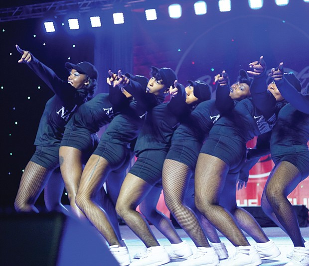 Cheerleaders from various school squads show off their moves in the CIAA Cheerleading Competition. The Virginia State University Woo Woos