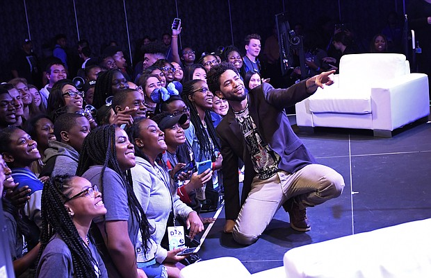 Actor Jussie Smollett poses for selfies with high school students at Disney Dreamers Academy with Steve Harvey and ESSENCE during a panel discussion Saturday, March 10, 2018 at Epcot in Lake Buena Vista, Fla. The 11th annual Disney Dreamers Academy, taking place March 8-11, 2018 is a career-inspiration program for distinguished high school students from across the U.S.