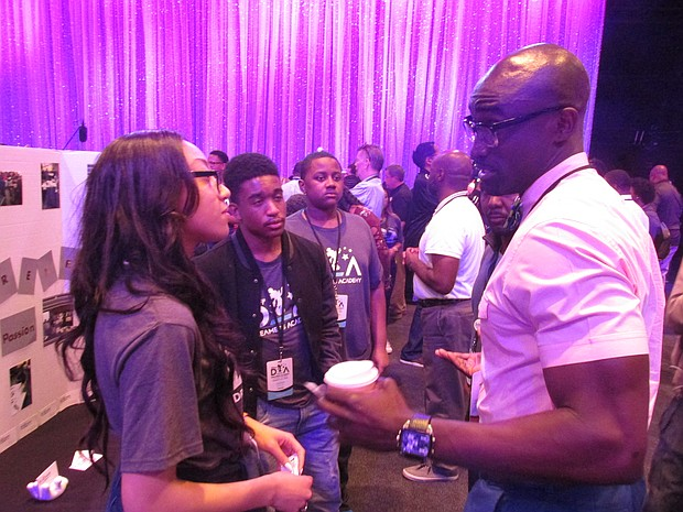 """Youth got the chance to network with professionals during the """"Career Open Mouse"""" at the Disney Dreamers Academy"""