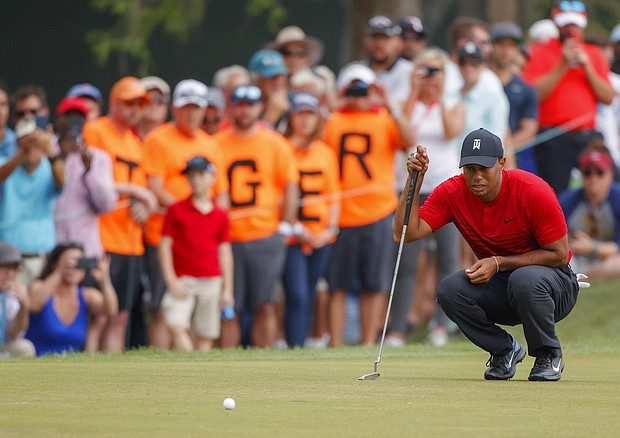 Tiger Woods lines up a putt on the 13th hole during the final round of the Valspar Championship golf tournament Sunday, March 11, 2018, in Palm Harbor, Fla. (AP Photo/Mike Carlson)