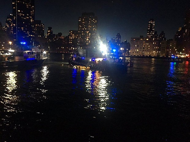 This image made from video provided by the New York City Police Department shows the scene of a helicopter crash in the East River in New York on Sunday, March 11, 2018. (New York City Police Department via AP)