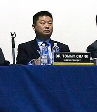 Superintendent Tommy Chang, flanked by School Committee member Michael O'Neil and President Michael Loconto.