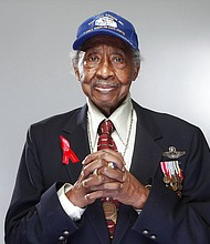 "In this Jan. 10, 2012 file photo, Tuskegee Airman Floyd Carter Sr. poses for a portrait during a news conference in New York for the film ""Red Tails,"" chronicling the heroism of the Tuskegee Airmen during WWII. (AP Photo/Carlo Allegri, File)"