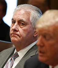 In this Jan. 10, 2018 file photo, Secretary of State Rex Tillerson listens as President Donald Trump speaks during a cabinet meeting at the White House in Washington. Tillerson is out as secretary of state. Trump tweeted this morning that he's naming CIA director Mike Pompeo to replace him. (AP Photo/Evan Vucci)