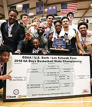 Grant High School players and coaches celebrate after winning their first state championship in basketball in 10 years Saturday with a 63-62 thriller final against cross town rival and defending state champions Jefferson High School.