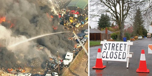 A KGW photo (left) shows firefighters dousing water on a huge fire that erupted at a scrap yard near Northeast 76th and Killingsworth Street Monday, sending toxic smoke throughout the city, destroying a nearby apartment and duplex, killing several pets and causing the evacuations of hundreds of residents.  Neighborhood streets (right) remained closed Tuesday.