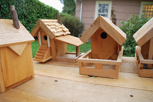 George Mayes uses recycled and found material as well as environmentally friendly, organic cedar to craft bird feeders that look like miniature mountain lodges.
