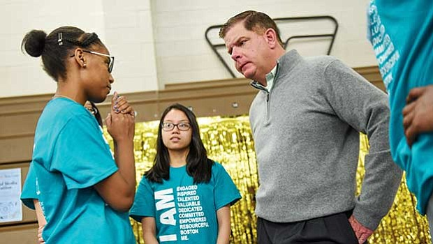 Mayor Martin Walsh speaks with teens during the Boston Centers for Youth and Family Youth Job & Resource Fair in Roxbury.