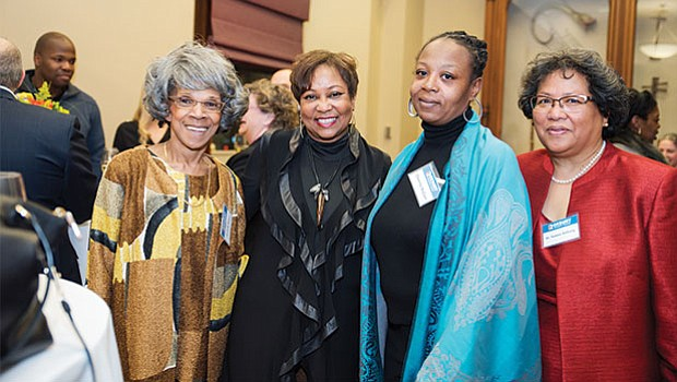 Dr. Valerie Roberson enjoys the welcome reception with other guests.