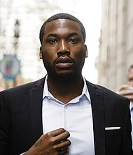"""In this Nov. 6, 2017 file photo, rapper Meek Mill arrives at the criminal justice center in Philadelphia. The mother of jailed rapper Meek Mill is calling on Philadelphia's district attorney to """"step in"""" and help her son. (AP Photo/Matt Rourke, File)"""