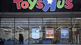 A person walks near the entrance to a Toys R Us store, in Wayne, N.J. Toys R Us's management has told its employees that it will sell or close all of its U.S. stores. (AP Photo/Julio Cortez, File)