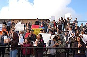 Roosevelt High School students assemble in the stands of their athletic field to add their voices to the issue of gun violence and school safety during a school walk-out in solidarity with similar actions Wednesday at schools across the nation.  Portland School Superintendent Guadalupe Guerrero and Oregon Gov.  Kate Brown and others also showed their support by attending the demonstration.