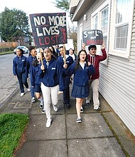 Students from St. Andrew Nativity School in northeast Portland march toward Martin Luther King Boulevard chanting and holding signs in solidarity with nationwide student-led protests pleading for gun reforms. The march on Wednesday came on the one month anniversary of the Marjory Stoneman Douglas High School mass shooting in Florida that killed 17.