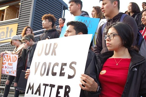 Classmates at Roosevelt High School walked out of school at 9:40 a.m. Wednesday and gathered outside for a rally to talk about gun laws in the U.S. and provide a moment of silence to memorialize the 17 who were shot down in Parkland, Fla. last month. They returned to class an hour later.
