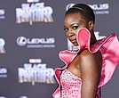 "In this Jan. 29, 2018 file photo, Danai Gurira, a cast member in ""Black Panther,"" arrives at the premiere of the film at The Dolby Theatre in Los Angeles. Featuring a predominantly black cast, the film that is an ode to Africa - with costuming and sets heavily inspired by African cultures - moved many viewers, including cast members themselves, to dress in African-themed garments for their viewing the film. (Photo by Chris Pizzello/Invision/AP, File)"