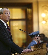 New Jersey Gov. Phil Murphy unveils his 2019 budget Tuesday, March 13, 2018, in the Assembly chamber of the Statehouse in Trenton, N.J. (AP Photo/Mel Evans)