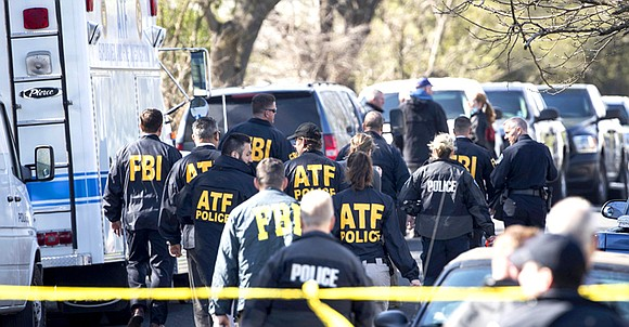Investigators believe a package bomb that killed a teenager and wounded a woman in Austin Monday is linked to a ...