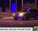 Investigators at the scene of a fatal accident involving a self driving Uber car on the street in Tempe, Ariz. Police in the city of Tempe said Monday, March 19, 2018, that the vehicle was in autonomous mode with an operator behind the wheel when the woman walking outside of a crosswalk was hit. (ABC-15.com via AP)