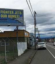A billboard message raises objections to noise from Oregon Air National Guard flights over residential areas near the Portland Airport, paid for by a resident of the adjacent Cully Neighborhood who is fighting the military's plans to increase a landing technique that makes the noise from landings even louder.