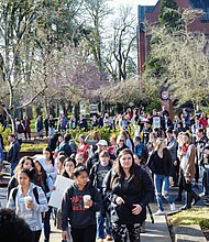 Pacific University students file out of classes and move toward the center of the university's Forest Grove campus to attend a rally and speak out against gun violence in solidarity with nationwide student protests March 14 on the one month anniversary of the mass shooting that killed 17 at a high school in Parkland, Fla.