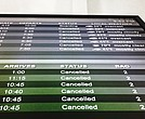 Southwest Airlines flights are displayed on an arrivals and departures board at Newark Liberty International Airport, Tuesday, March 20, 2018, in Newark, N.J. A spring nor'easter is starting to slam the Northeast with strong winds and a foot or more of snow expected in some parts of the region. (AP Photo/Jenny Kane)