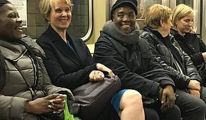 Cynthia Nixon speaks to voters on the subway