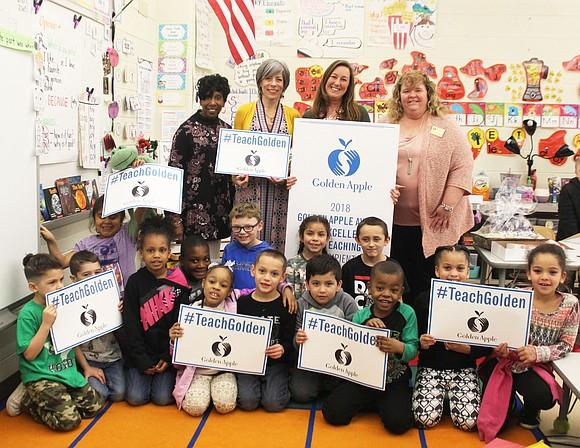 Golden Apple surprised Lynne Thigpen Elementary School First Grade Teacher Carrie Garrett with the highly respected Golden Apple Award of ...
