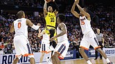 Jairus Lyles of the University of Maryland-Baltimore County goes up for a shot against the University of Virginia Cavaliers during the second half of the upset game last Friday during the NCAA Tournament's first round in Charlotte, N.C.