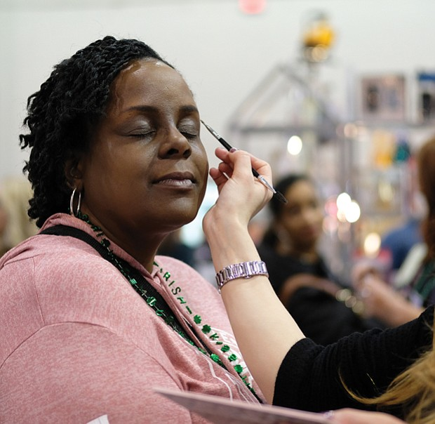 Women's day // Rochelle Bland gets her makeup done by Elmaze of MAC Cosmetics during the Southern Women's Show on Saturday at the Richmond Raceway Complex.