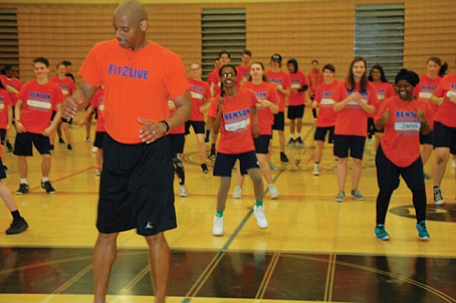 Benson High School Principal Curtis Wilson inspires students by teaching a Zumba dance class during a freshmen physical education class as a way of connecting with the over 300 new students that come to Benson each year.